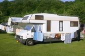 Caravan van in the green meadow camping — Stock Photo