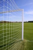 Net soccer goal football green grass field — Stock Photo