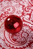 Chrsitmas red ball over indian pattern — Stock Photo