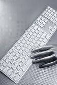 Computer keyboard aluminum silver hand — Stock Photo