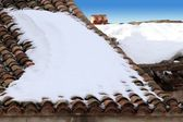 Aged clay roof tiles snowed under winter snow — Stock Photo