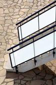 Glass banisters stairway with masonry floor — Stock Photo