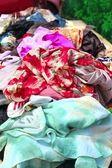 Textile fabric colorful market bargain showcase — Stock Photo