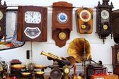 Antiques fair market wall old clocks — Stock Photo