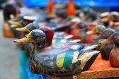 Duck decoy arrangement colorful row — Stock Photo