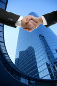 Businessman partners shaking hands with suit — Stock Photo