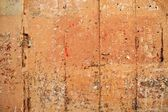 Aged grunge wooden pink orange painted door — Stock Photo