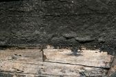 Black paint in wooden boat hull grunge aged — Stock Photo