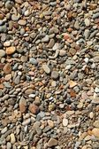 Background texture of little stones from beach — Stock Photo
