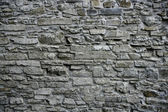 Antique grunge old gray stone wall masonry — Stock Photo