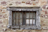 Aged wooden window in masonry stone house — Stock Photo