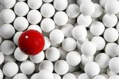 Alone one billiard red ball little white balls — Stock Photo