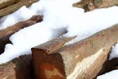 Snow on wood beams in winter time — Stock Photo