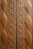 Embossed brass vintage old church door detail — Stock Photo