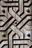 Old aged wooden door iron handcraft deco — Stock Photo