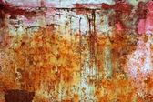 Rusty weathered painted iron aged metal — Stock Photo