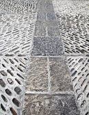 Rolling stones mosaic medieval soil floor Spain — Stock Photo