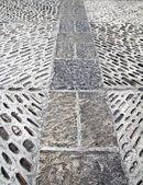 Rolling stones mosaic medieval soil floor Spain — Stock Photo