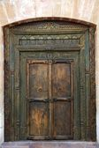Ancient eastern indian wooden door — Stock Photo