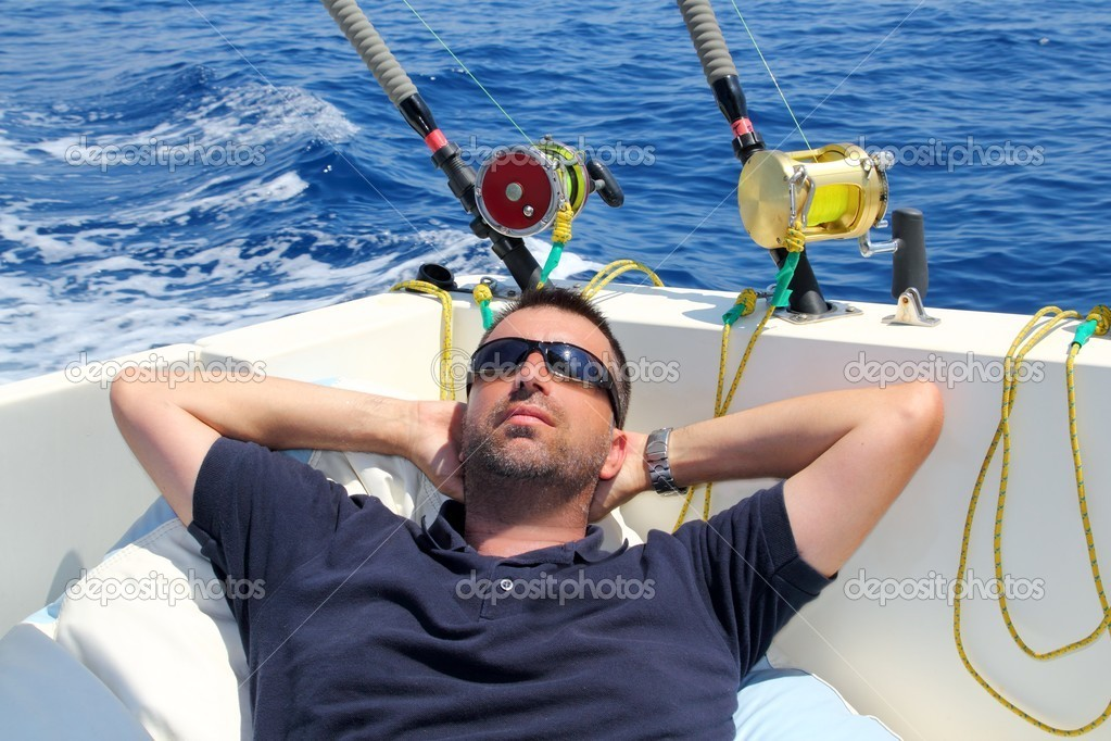 Sailor man fishing resting in boat summer vacation blue sea  Stock Photo #5500235