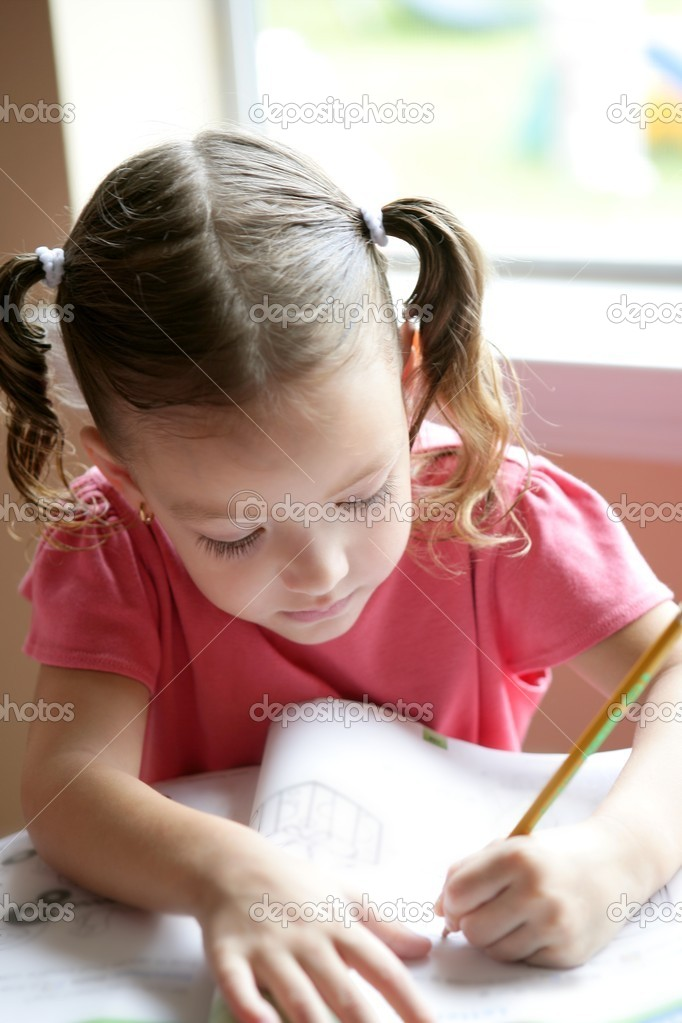 Little toddler girl writing at school desk, homework — Stock Photo #5500274