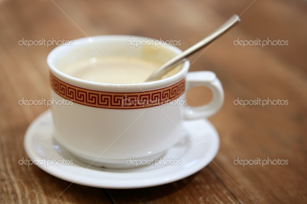 Coffe with milk white cup over teak wooden background  Stock Photo #5500760