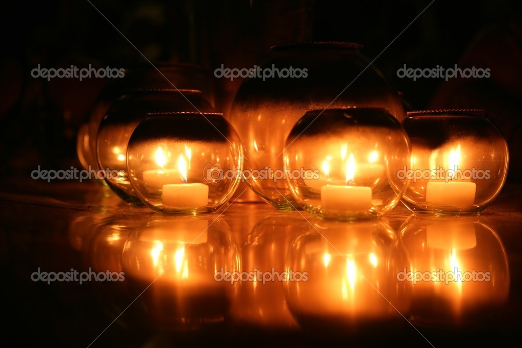 Candlelight of candles in round glasses decoration over black background — Stock Photo #5502945