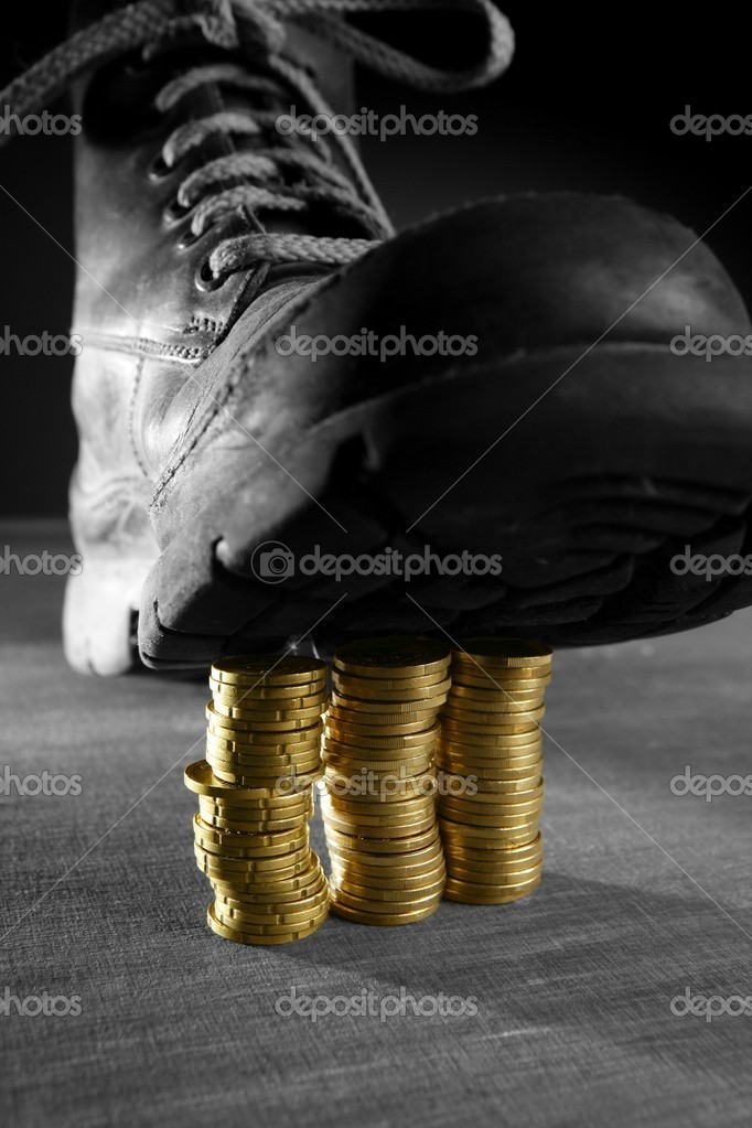 Treading three coins columns with a boot. Financial credit crisis metaphor — Stock Photo #5503584