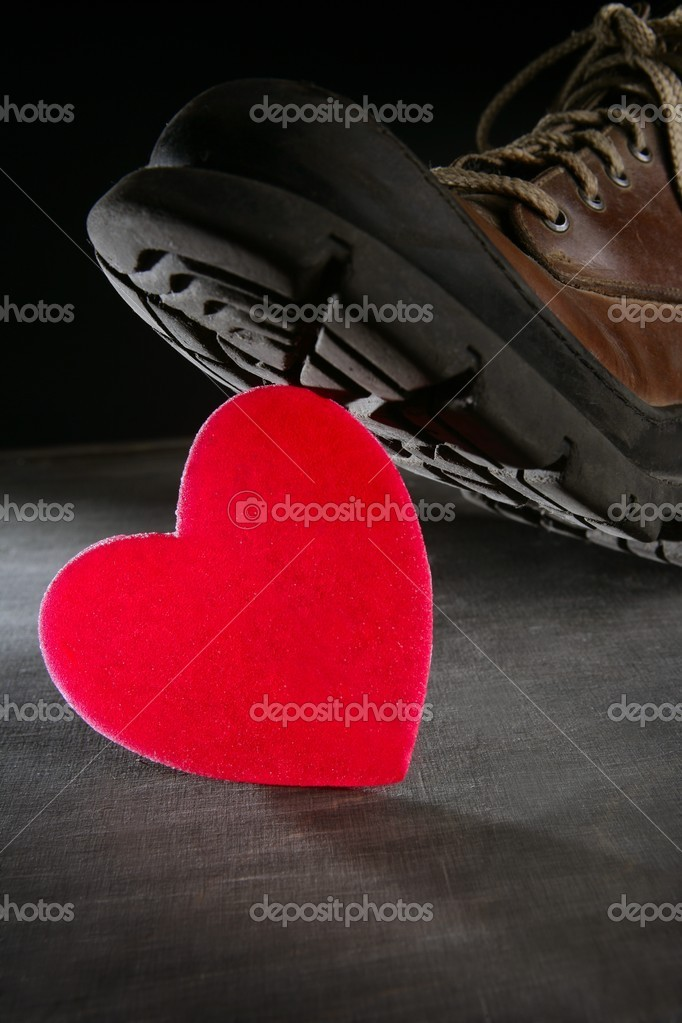 Kill the love or health metaphor. Boot treading a red valentines heart — Stock Photo #5503588