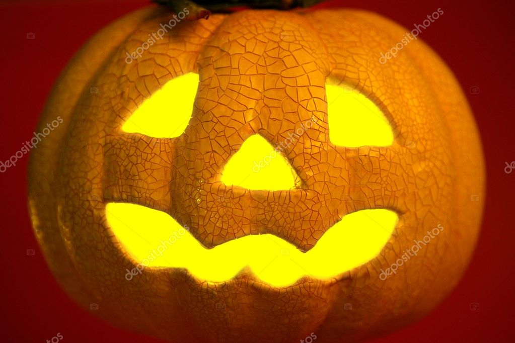 Glowing yellow light inside an orange halloween pumpkin  Stock Photo #5503612