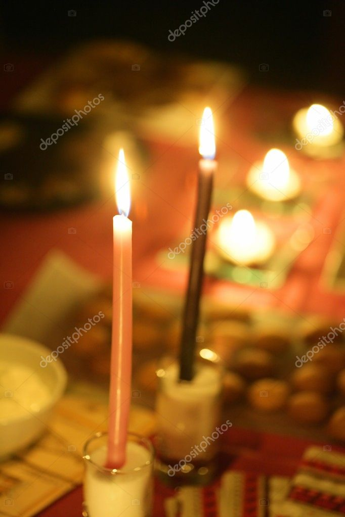 Candle warm golden light in a cold christmas night — Stock Photo #5504188