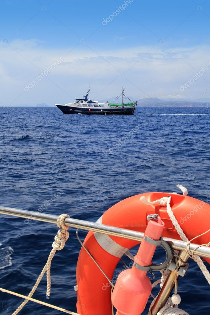 Fishing trawler professional boat working in blue ocean sea — Stock Photo #5505387
