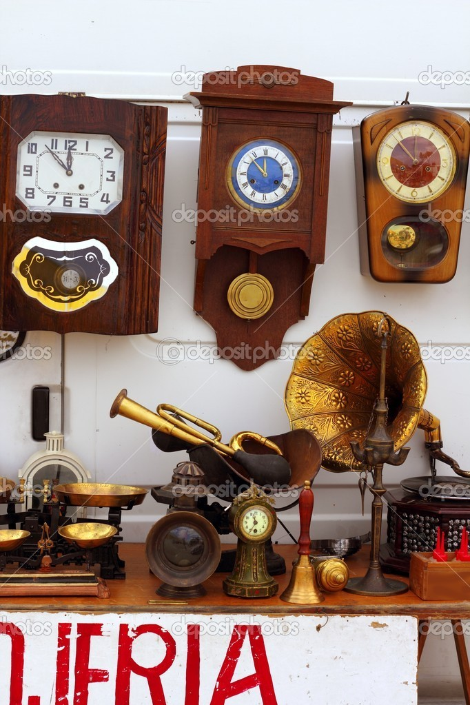 Antiques fair market wall old clocks vintage stuff  Stock Photo #5506179