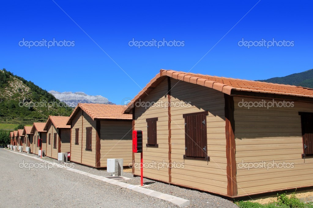 Wooden bungalow houses in camping area in Pyrenees mountains — Stock Photo #5506255