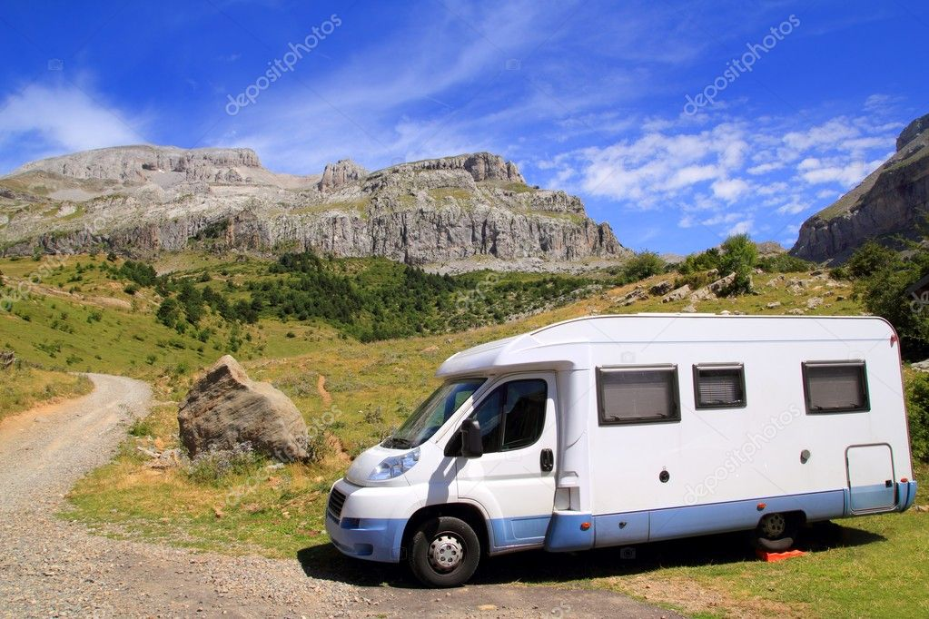 Camper van in mountains blue sky nature sunny outdoor — Stock Photo #5506266