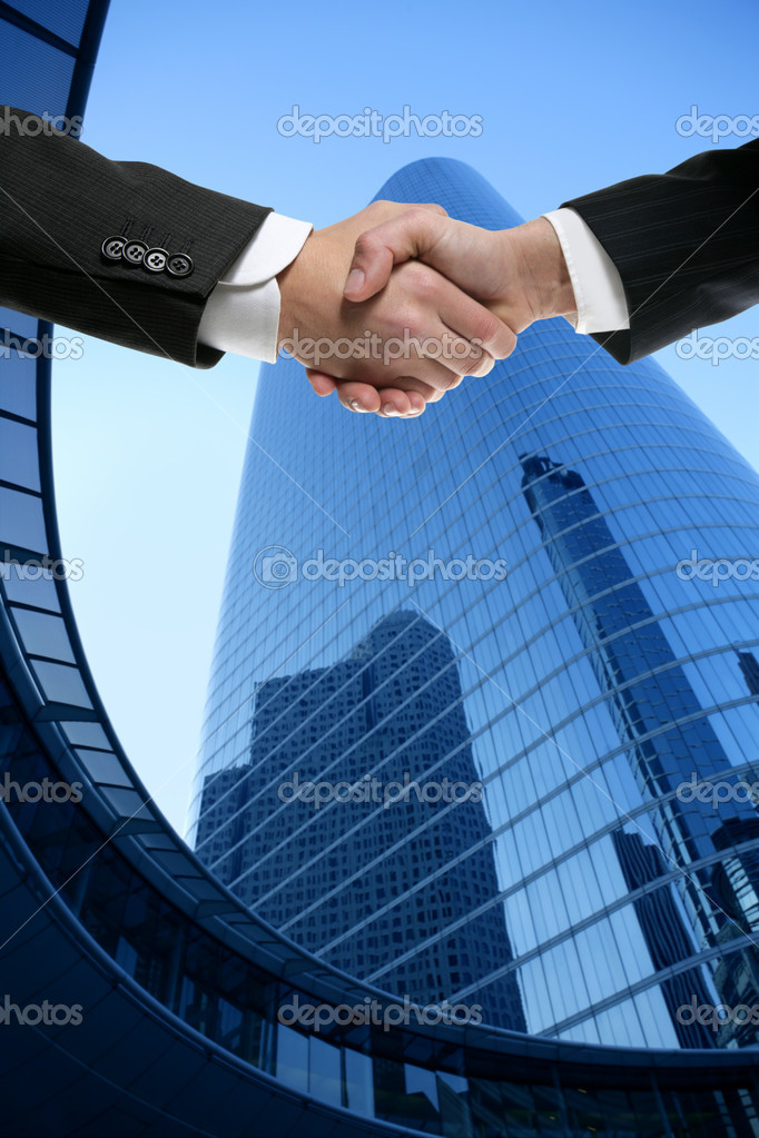 Businessman teamwork partners shaking hands with suit — Stock Photo #5507687