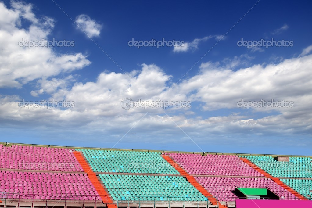 Stadium colorful grandstand stands blue sky — Stock Photo #5508519