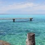 Formentera Illetes turquoise sea wooden pier — Stock Photo