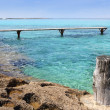 Formentera Illetes turquoise sea wooden pier — Stock Photo