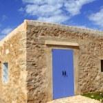 Stone house masonry blue sky door windows — Stock Photo