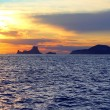 Ibiza sunset Es Vedra from Formentera balearic - Stock Photo