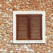 Brown wooden window in masonry wall — Stock Photo
