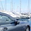 Luxury car and yacht sailboats on Spain marina - Stock Photo