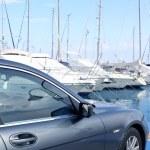 Luxury car and yacht sailboats on Spain marina — Stock Photo