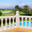 Golf course from pool housel white balustrade - Stock Photo