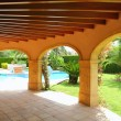 Stock Photo: Colonnade archs house swimming pool garden