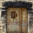 Medieval wooden door in stone wall Pyrenees — Stock Photo