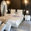 Bedroom modern silver oval mirror white bed — Stock Photo