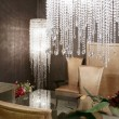 Dining room crystal lamp golden chairs - Stock Photo