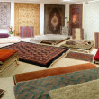 Arabic carpet shop exhibition colorful carpets - Stock Photo